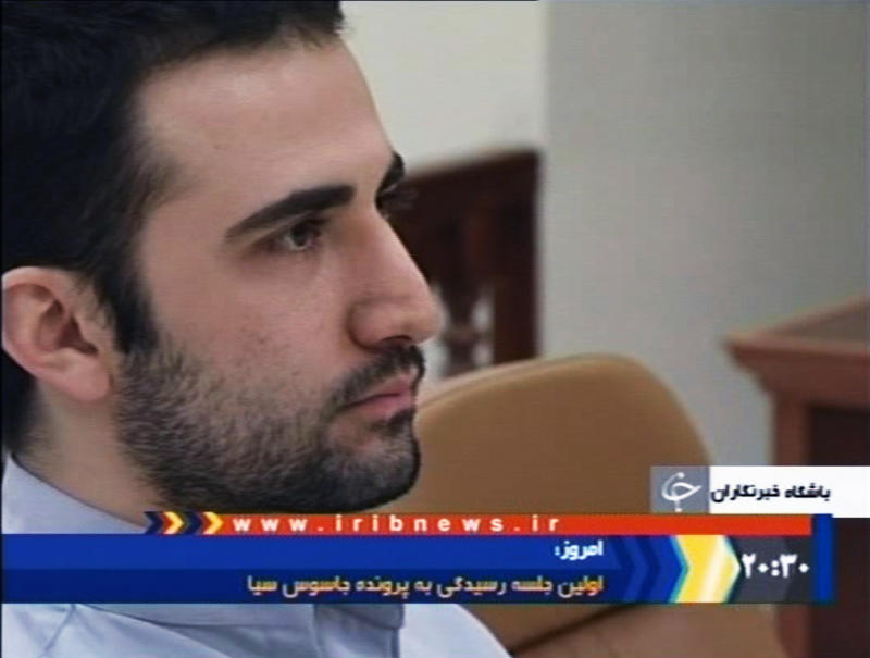 FILE - In this Tuesday, Dec. 27, 2011  video frame grab image made from the Iranian broadcaster IRIB TV, U.S. citizen Amir Mirzaei Hekmati, accused by Iran of spying for the CIA, sits in Tehran's revolutionary court, in Iran. Iran's Supreme Court has ordered the retrial of an ex-U.S. Marine who was sentenced to death on charges of working for the CIA, a news agency reported Monday, March 5, 2012. Amir Hekmati, 28, was sentenced to death in January, the first American to receive a death penalty since the 1979 Islamic Revolution in Iran. Hekmati was born in Arizona. His parents are of Iranian origin.(AP Photo/IRIB, File) IRAN OUT TV OUT