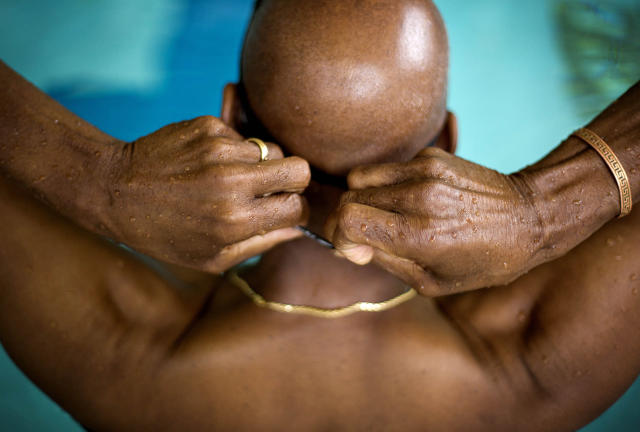 "<p>Jacques Ricks, 66, adjusts the straps to his goggles before the start of the 100-meter freestyle swim event in the Dekalb County Senior Olympics in Decatur, Ga. ""I was a little nervous but that's just normal right?"" said Ricks, competing in his third olympics, May 19, 2014. (AP Photo/David Goldman) </p>"