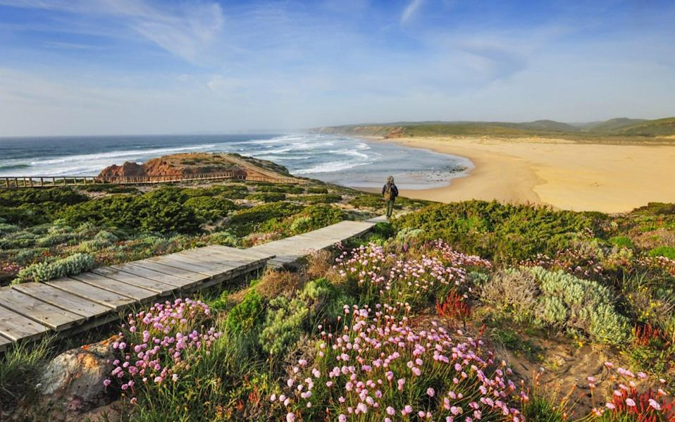 Walk the wild west: A week-long rambling holiday will take you along dunes and clifftops, to isolated coves and paths lined with Mediterranean flora