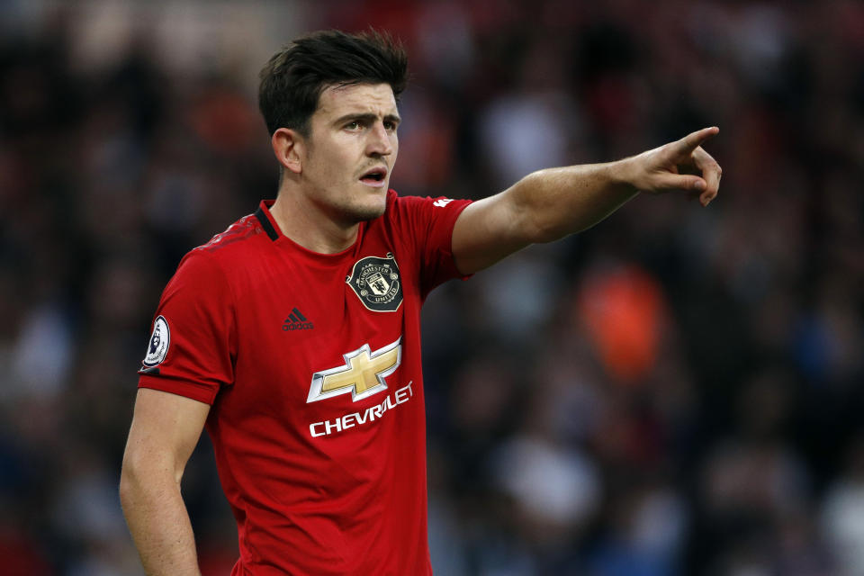 Manchester United's Harry Maguire gestures during the English Premier League soccer match between Wolverhampton Wanderers and Manchester United at the Molineux Stadium in Wolverhampton, England, Monday, Aug. 19, 2019. (AP Photo/Rui Vieira)