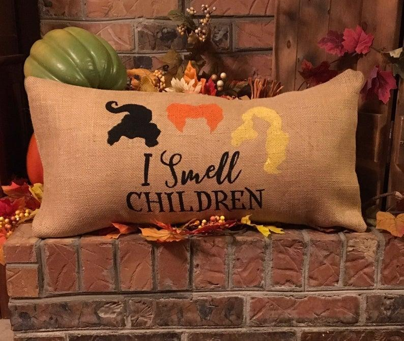 "<p>You'd be hard-pressed to find someone who didn't love <strong>Hocus Pocus</strong>, and so this <a href=""https://www.popsugar.com/buy/I-Smell-Children-Burlap-Pillow-476243?p_name=%22I%20Smell%20Children%22%20Burlap%20Pillow&retailer=etsy.com&pid=476243&price=35&evar1=casa%3Auk&evar9=46461771&evar98=https%3A%2F%2Fwww.popsugar.com%2Fhome%2Fphoto-gallery%2F46461771%2Fimage%2F46461774%2FHocus-Pocus-Burlap-Pillow&list1=pillows%2Challoween%2Challoween%20decor&prop13=api&pdata=1"" rel=""nofollow"" data-shoppable-link=""1"" target=""_blank"" class=""ga-track"" data-ga-category=""Related"" data-ga-label=""http://www.etsy.com/listing/660081672"" data-ga-action=""In-Line Links"">""I Smell Children"" Burlap Pillow</a> ($35, originally $39) is sure to be a hit with everyone.</p>"