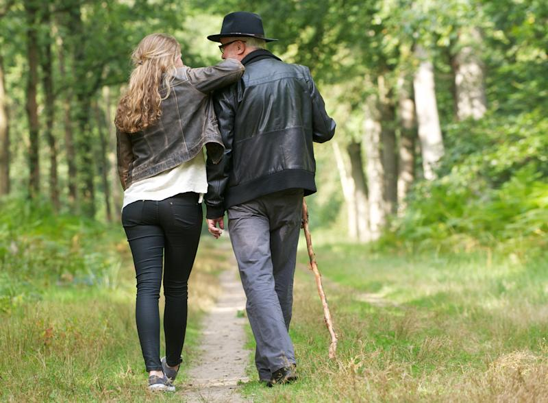 Portrait of a father and daughter enjoying a walk in the woods