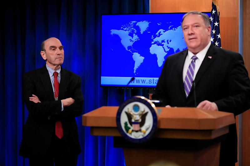 Elliott Abrams, left, listens to Secretary of State Mike Pompeo talk about Venezuela at the State Department in Washington, Friday, Jan. 25, 2019.