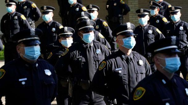PHOTO: Houston Police cadets wear masks as they prepare to have their class photo taken during a graduation ceremony at the Houston Police Academy, amid the COVID-19 pandemic, Friday, May 1, 2020, in Houston. (David J. Phillip/AP Photo)