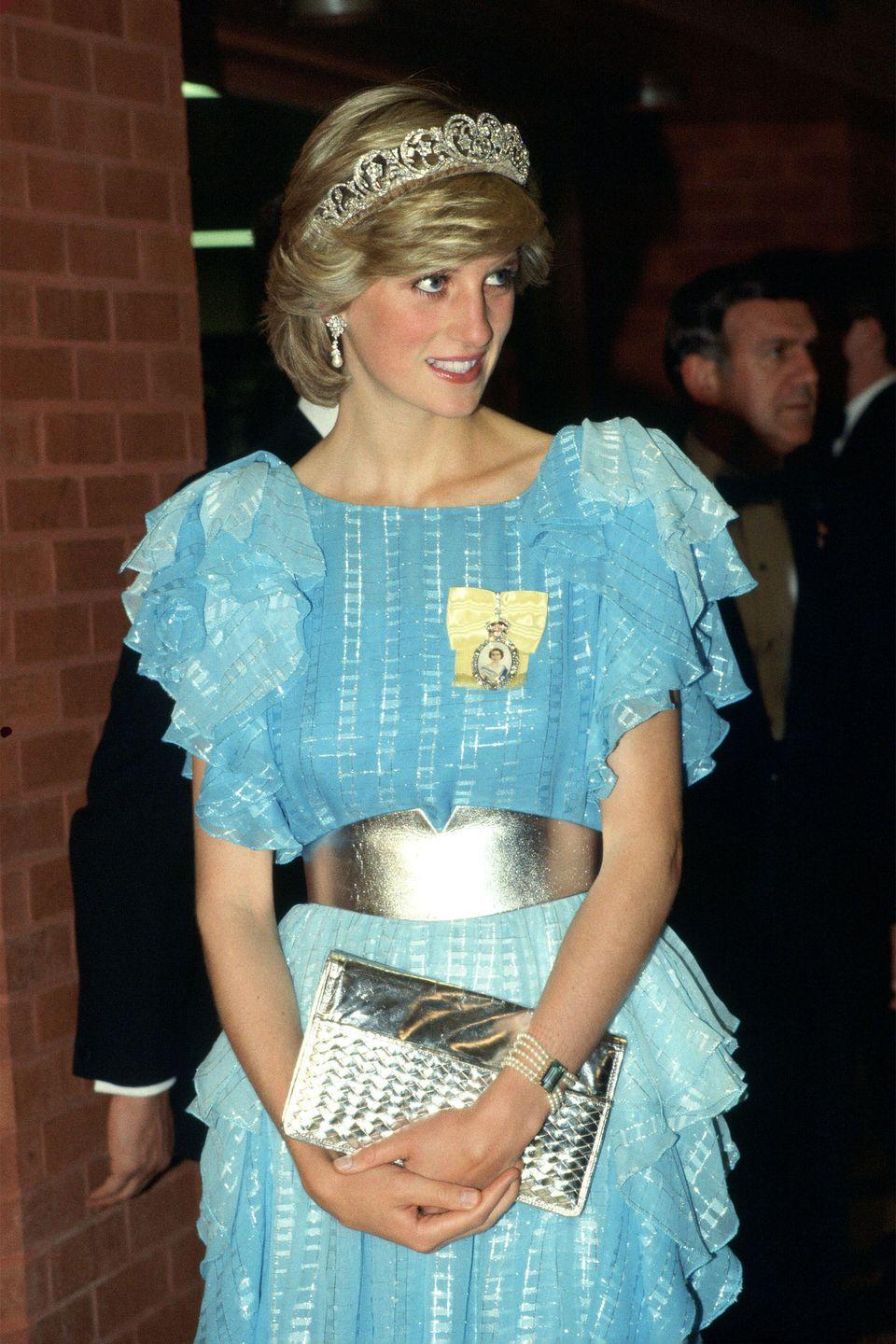 <p>Attending a dinner in a Bruce Oldfield outfit, accessorised with the Diamond Spencer Tiara, a metallic belt, and clutch.</p>