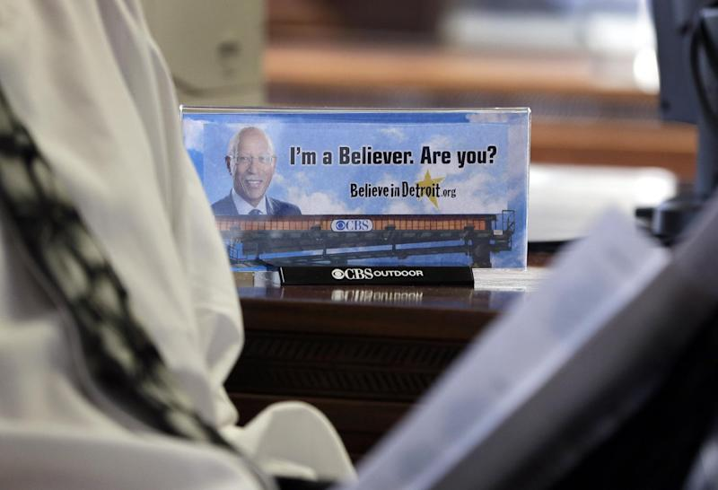 """A photograph of a billboard is seen on Detroit Mayor Dave Bing's desk during his interview with the Associated Press, Wednesday, March 6, 2013. The mayor says he believes Michigan Gov. Rick Snyder will appoint an emergency manager over the city's finances and that he """"intends to work collaboratively"""" with that person. Bing says he's considering whether to appeal a determination by a state-appointed review team and Snyder that Detroit has not put forward a plan to resolve the city's serious financial problem. (AP Photo/Carlos Osorio)"""