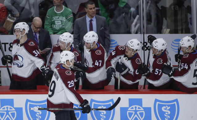 Colorado Avalanche center Nathan MacKinnon (29) celebrates with teammates after scoring against the Chicago Blackhawks during the second period of an NHL hockey game Tuesday, March 6, 2018, in Chicago. (AP Photo/Kamil Krzaczynski)