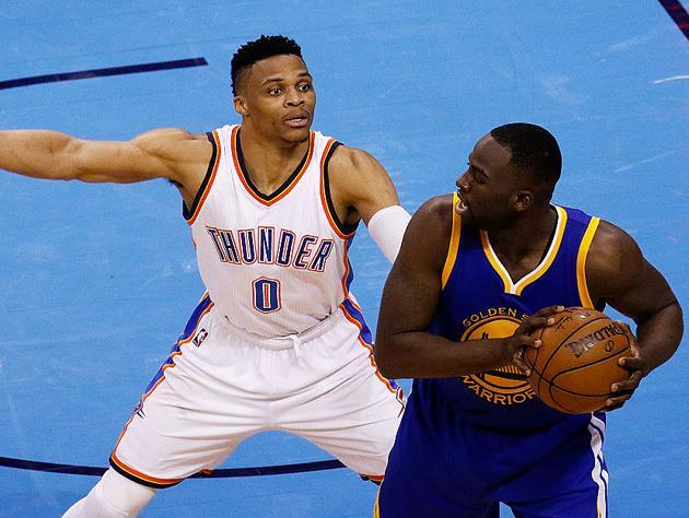 Russell Westbrook envelops Draymond Green. (Getty Images)