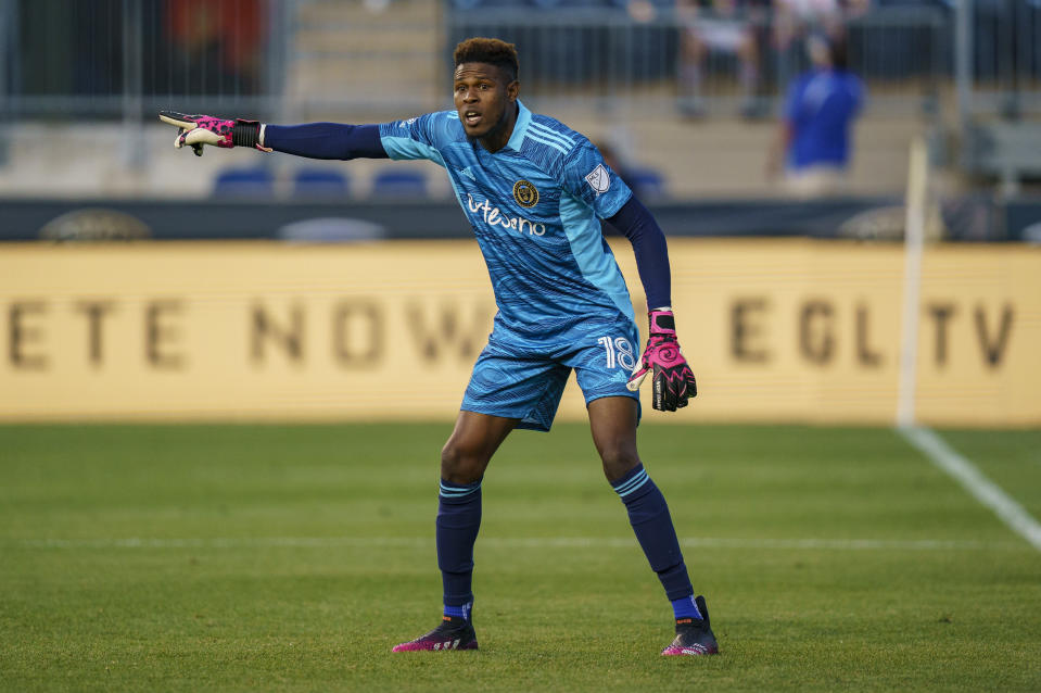Philadelphia Union's Andre Blake directs his team during the first half of an MLS soccer match against the Columbus Crew, Wednesday, June 23, 2021, in Chester, Pa. (AP Photo/Chris Szagola)