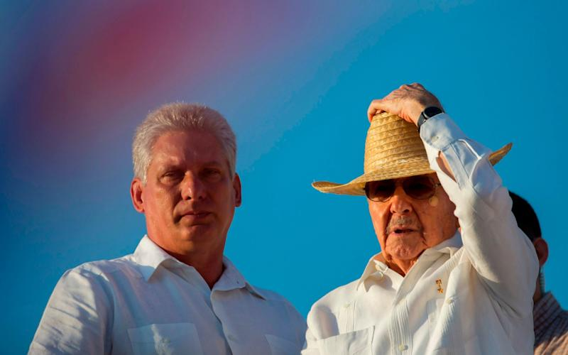 Cuba's First Vice President Miguel Diaz-Canel, left, stands with President Raul Castro during the May Day parade in Havana, May, 2016 - AP