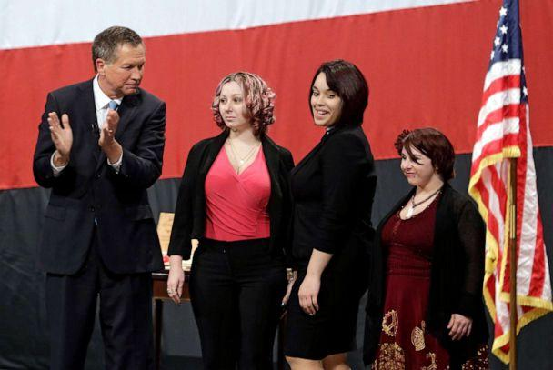 PHOTO: Ohio Gov. John Kasich, from left, introduces Amanda Berry, Gina DeJesus and Michelle Knight during his State of the State address at the Performing Arts Center Monday, Feb. 24, 2014, in Medina, Ohio. (Tony Dejak/AP Photo)