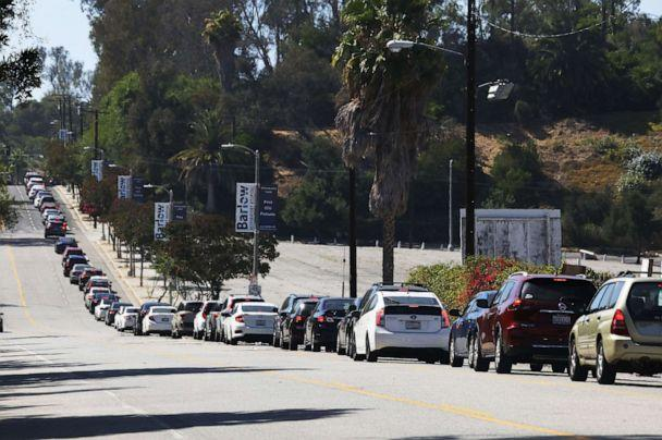 PHOTO: Motorists wait in line to enter the COVID-19 testing center at Dodger Stadium in Los Angeles, July 08, 2020. (Mario Tama/Getty Images)