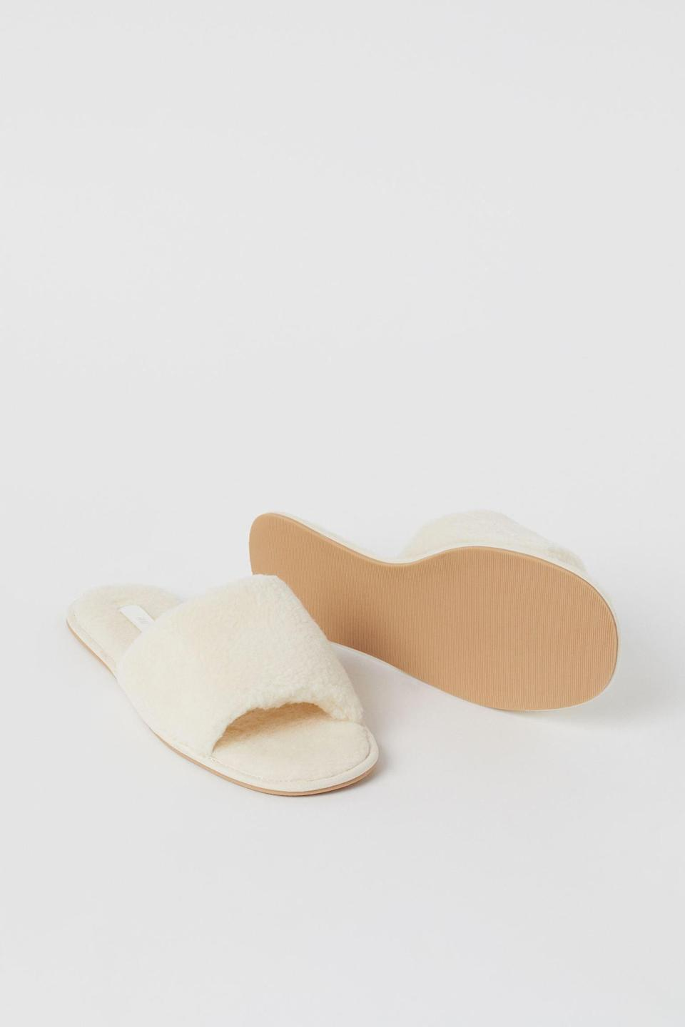 <p>These <span>Faux Shearling Slippers</span> ($18) look extremely soft and comfortable, thanks to the fabric and the wide foot strap.</p>
