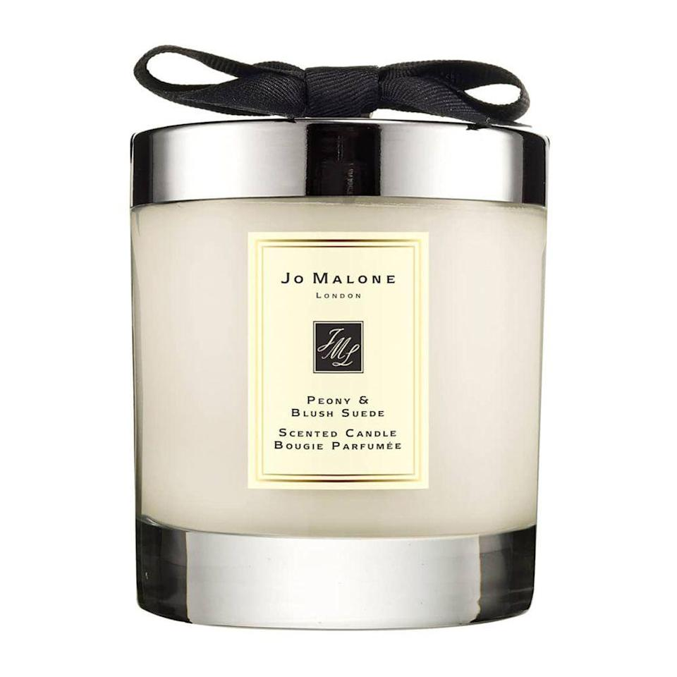 """<p><strong>Jo Malone London</strong></p><p>nordstrom.com</p><p><strong>$69.00</strong></p><p><a href=""""https://go.redirectingat.com?id=74968X1596630&url=https%3A%2F%2Fwww.nordstrom.com%2Fs%2Fjo-malone-london-peony-blush-suede-scented-candle%2F3584269&sref=https%3A%2F%2Fwww.bestproducts.com%2Flifestyle%2Fnews%2Fg2100%2Fperfect-gift-ideas-under-100%2F"""" rel=""""nofollow noopener"""" target=""""_blank"""" data-ylk=""""slk:Shop Now"""" class=""""link rapid-noclick-resp"""">Shop Now</a></p><p>Pamper her with this peony and blush suede candle by Jo Malone. She'll love lighting it to shift her atmosphere to something more feminine and elegant.</p><p><strong>More:</strong> <a href=""""https://www.bestproducts.com/home/decor/g1281/best-scented-candles/"""" rel=""""nofollow noopener"""" target=""""_blank"""" data-ylk=""""slk:Our Absolute Favorite Scented Candles"""" class=""""link rapid-noclick-resp"""">Our Absolute Favorite Scented Candles</a></p>"""