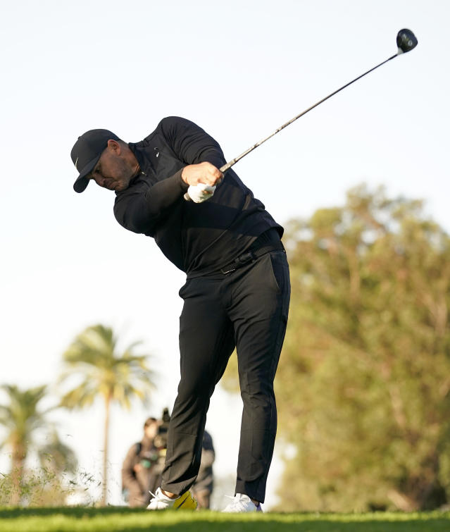 Brooks Koepka hits his second shot on the 12th hole during the first round of the Genesis Invitational golf tournament at Riviera Country Club, Thursday, Feb. 13, 2020, in the Pacific Palisades area of Los Angeles. (AP Photo/Ryan Kang)