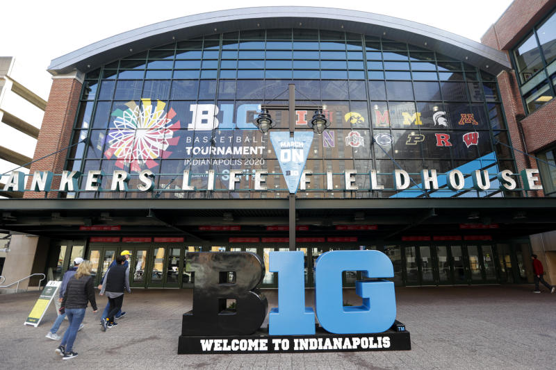 UPDATES TOURNAMENT CANCELLED - Fans enter The Bankers Life Fieldhouse for a game at the Big Ten Conference tournament in Indianapolis, Thursday, March 12, 2020. The Big Ten Conference announced that remainder of the men's NCAA college basketball games tournament was cancelled. (AP Photo/Michael Conroy)