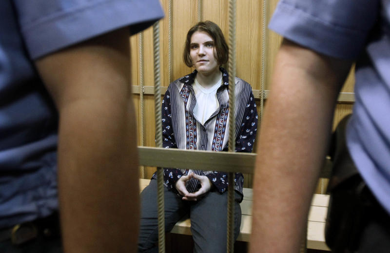 """FILE - In this June 20, 2012 file photo, Yekaterina Samutsevich, a member of the feminist punk band Pussy Riot, sits in a district court in Moscow. The trial of feminist punk rockers who chanted a """"punk prayer"""" against President Vladimir Putin from the pulpit of Russia's largest cathedral started in Moscow Friday, July 20, 2012 amid controversy over the prank that divided devout believers, Kremlin critics and ordinary Russians. (AP Photo/Misha Japaridze, File)"""