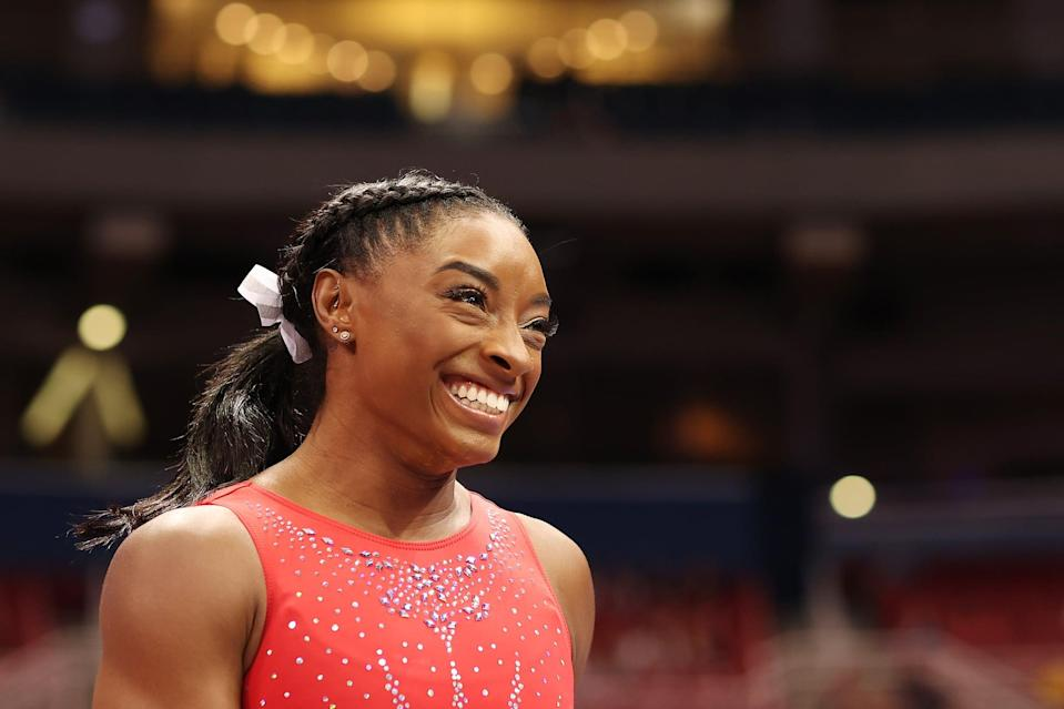 ST LOUIS, MISSOURI - JUNE 27: Simone Biles reacts during warm ups prior to the Women's competition of the 2021 U.S. Gymnastics Olympic Trials at America's Center on June 27, 2021 in St Louis, Missouri. (Photo by Carmen Mandato/Getty Images)