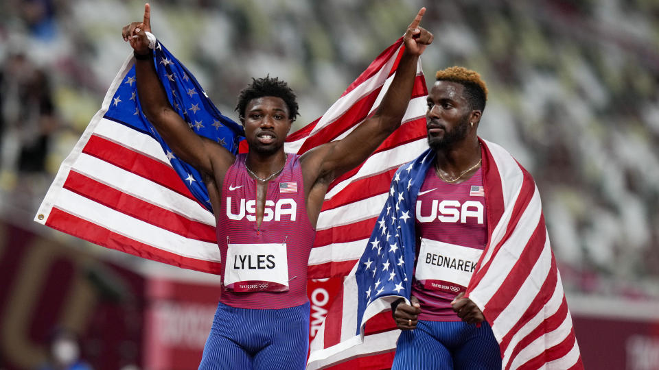 Kenneth Bednarek, right, of United States, celebrates after winning the silver medal with bronze medalist Noah Lyles, also of the United States, in the men's 200-meter final at the 2020 Summer Olympics, Wednesday, Aug. 4, 2021, in Tokyo. (AP Photo/Petr David Josek)