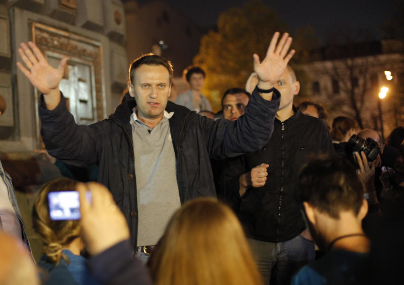 FILE - In this Tuesday, May 8, 2012 file photo, Alexei Navalny, a prominent anti-corruption whistle blower and blogger speaks to protesters gathered near the presidential administrations building in downtown Moscow, a day after Putin's inauguration as president. 36-year-old Navalny, one of President Vladimir Putin's fiercest critics, was a driving force behind last winter's wave of anti-Putin rallies. Over the winter, the anti-corruption activist spearheaded a series of rallies in Moscow that drew up to 100,000 people to the streets ahead of the March vote that handed Putin a third presidential term.. (AP Photo/Alexander Zemlianichenko Jr, File)