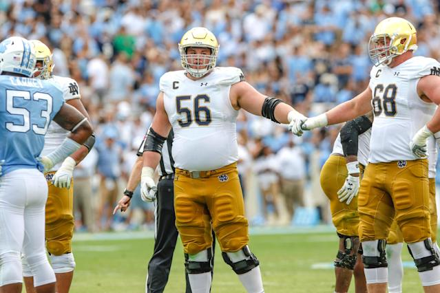 """Notre Dame's Quenton Nelson (56) and <a class=""""link rapid-noclick-resp"""" href=""""/ncaaf/players/230858/"""" data-ylk=""""slk:Mike McGlinchey"""">Mike McGlinchey</a> (68) cannot count how many times they've bumped fists. (Rick Kimball/IrishSportsDaily)"""