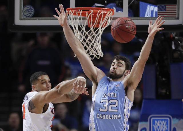 Virginia forward Isaiah Wilkins (21) passes the ball against North Carolina forward Luke Maye (32) in the first half of an NCAA college basketball game during the championship game of the Atlantic Coast Conference men's tournament Saturday, March 10, 2018, in New York. (AP Photo/Julie Jacobson)