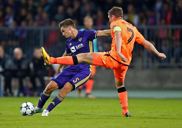 Soccer Football - Champions League - Maribor vs Liverpool - Ljudski vrt, Maribor, Slovenia - October 17, 2017 NK Maribor's Blaz Vrhovec in action with Liverpool's James Milner REUTERS/Srdjan Zivulovic