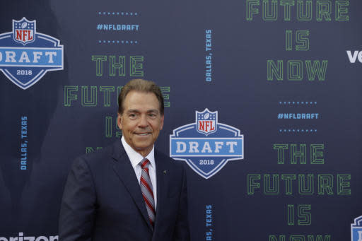 Alabama head coach Nick Saban poses for photos on the red carpet before the first round of the NFL football draft, Thursday, April 26, 2018, in Arlington, Texas. (AP Photo/Eric Gay)