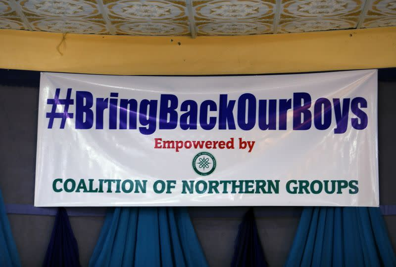 "A sign reading ""#BringBackOurBoys"" is seen during a press conference organized by Coalition of Northern Groups following the abduction of hundreds of schoolboys, in Kankara"