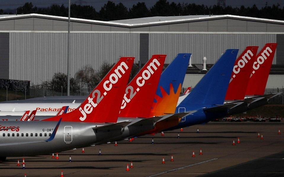 Jet2 planes are seen parked at Birmingham airport as coronavirus spread - Reuters
