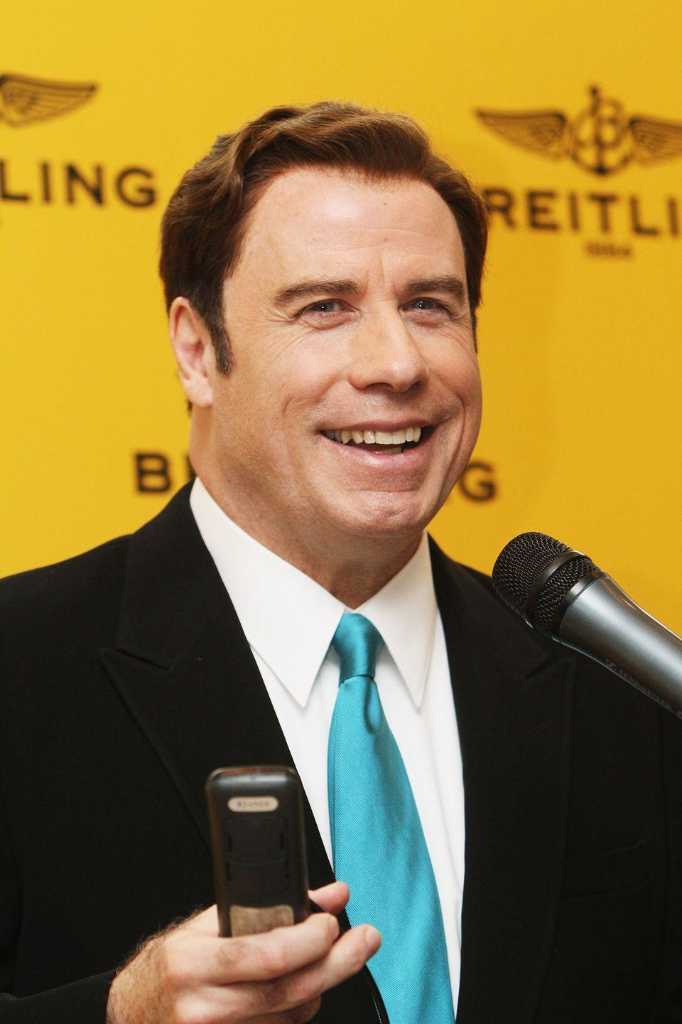 """<p>Who would Travolta be without his """"Greased Lightning"""" gelled back mane? </p>"""