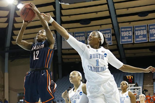 UT-Martin's Jasmine Newsome (12) goes to the basket against North Carolina's Stephanue Mavunga (1) and Latifah Coleman, center, during the first half of a first-round game of the NCAA women's college basketball tournament, Sunday, March 23, 2014in Chapel Hill, N.C. (AP Photo/Ellen Ozier)