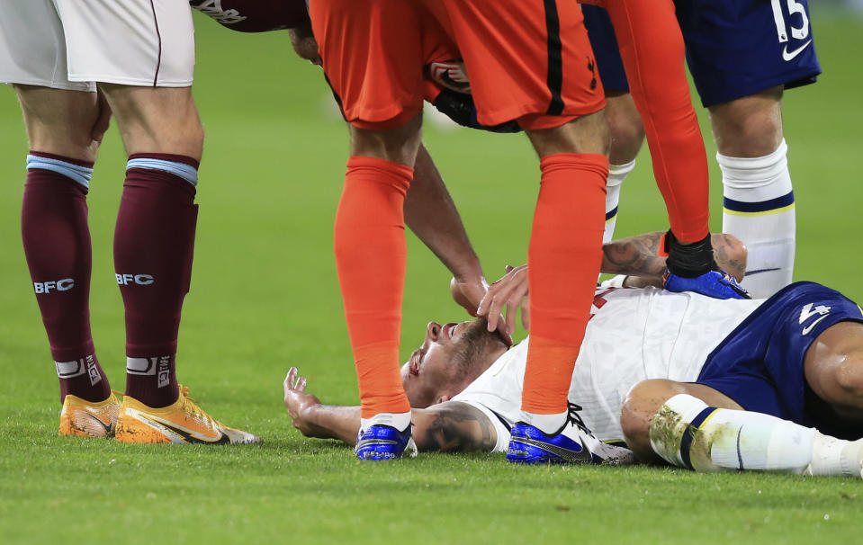 FILE - Tottenham's Toby Alderweireld is checked by fellow players after injuring his head during the English Premier League soccer match between Burnley and Tottenham Hotspur at Turf Moor stadium, Burnley, England, in this Monday, Oct. 26, 2020, file photo. U.S. Soccer, Major League Soccer and the National Women's Soccer League are joining a trial program that will allow teams two additional substitutes for suspected concussions in each match. The English Premier League has allowed use of concussion substitutes since early February. (Lindsey Parnaby/Pool via AP, File)