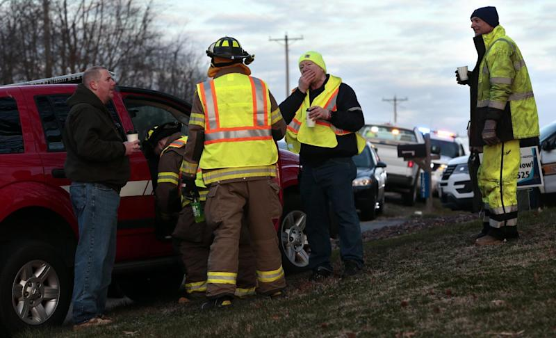 Firefighters and other emergency workers at the scene near Silver Lake, where a submerged SUV was found with a baby inside in Highland, Ill., on Thursday, March 16, 2017. The infant is being treated at a St. Louis hospital after the car the child was in rolled into the lake. (Robert Cohen/St. Louis Post-Dispatch via AP)