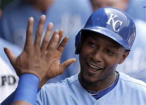 Kansas City Royals' Jarrod Dyson celebrates in the dugout after scoring on a single by Alex Gordon during the third inning of a baseball game against the Chicago White Sox, Sunday, June 23, 2013, in Kansas City, Mo. (AP Photo/Charlie Riedel)