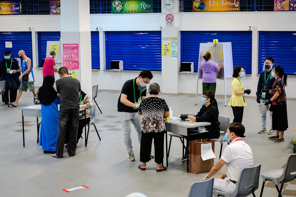 People registering to vote at the Dunearn Secondary School polling centre on 10 July. (PHOTO: Joseph Nair for Yahoo News Singapore)