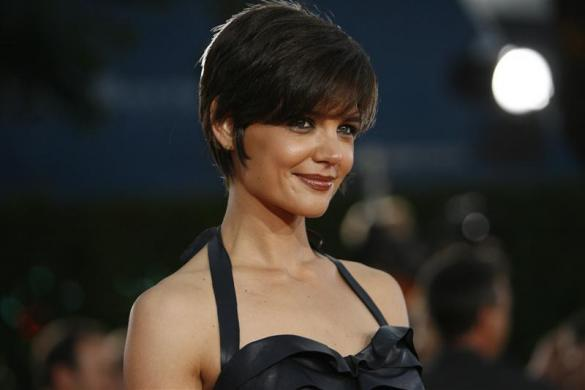 "Actress Katie Holmes poses at the premiere of ""Tropic Thunder"" at the Mann's Village theatre in Westwood, California August 11, 2008."