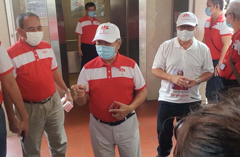 Progress Singapore Party's Tan Cheng Bock (centre) on a walkabout with Marymount SMC's candidate Dr Ang Yong Guan (right) at Bishan North Shopping Mall. (PHOTO: Yahoo News Singapore/Wan Ting Koh)