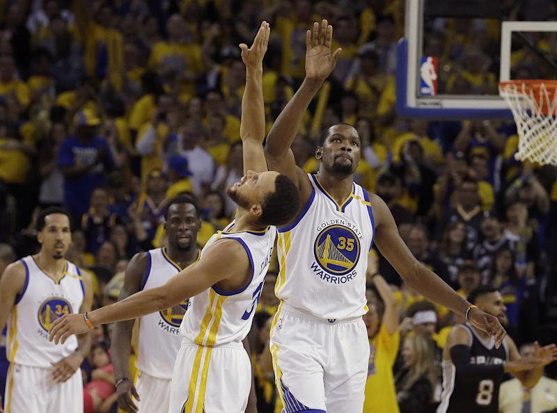 Durant has fit right in with Steph Curry and Co. (AP)