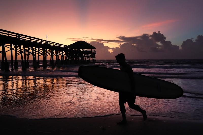 Surfer Scott Norwood prepares to go in the water as Hurricane Dorian approaches Florida, on August 31, 2019 in Cocoa Beach, Florida. (Photo: Mark Wilson/Getty Images)