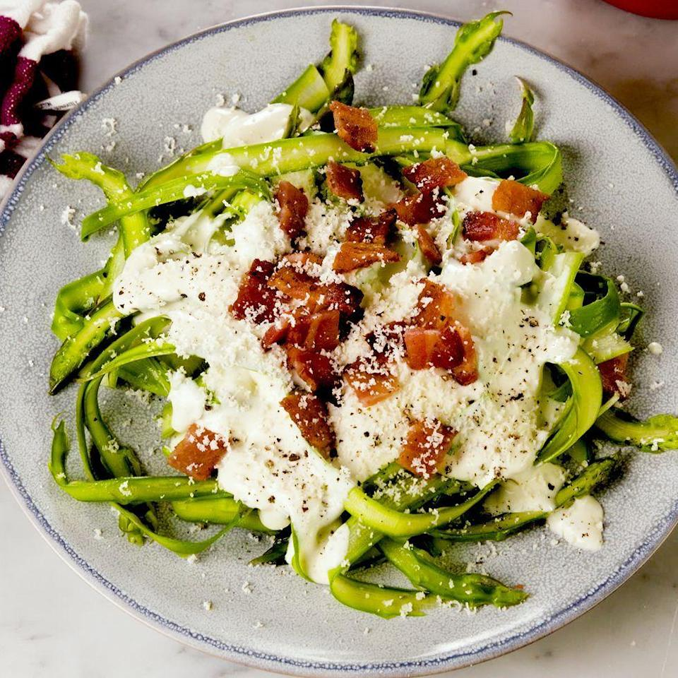"<p>Forget courgetti...Asparagus noodles are the new low-carb trend you need to know about.</p><p>Get the <a href=""https://www.delish.com/uk/cooking/recipes/a34939836/asparagus-bacon-alfredo-recipe/"" rel=""nofollow noopener"" target=""_blank"" data-ylk=""slk:Bacon-Asparagus Alfredo"" class=""link rapid-noclick-resp"">Bacon-Asparagus Alfredo</a> recipe. </p>"