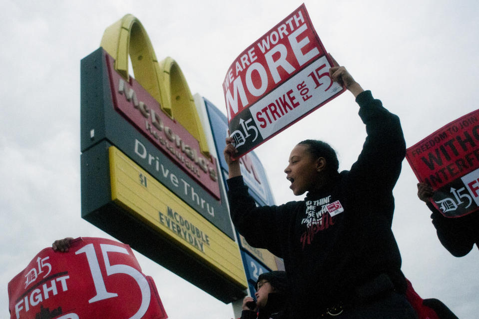 <p> Fast-food worker Michelle Osborn, 23, of Flint, Mich. shouts out chants as she and a few dozen others strike outside of a McDonald's restaurant on Wednesday, July 31, 2013 in Flint. A few thousand fast-food workers in seven cities took to the streets demanding better pay, the right to unionize and a more than doubling of the federal minimum hourly wage from $7.25 to $15. (AP Photo/The Flint Journal, Jake May)</p>