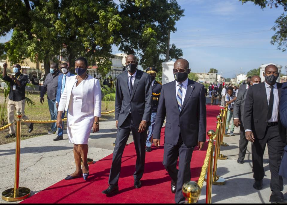 FILE - Haiti's President Jovenel Moise, center, accompanied by his wife Martine, and Prime Minister Joseph Jouthe, center right, arrive to a mausoleum to honor revolutionary leaders Alexandre Petion and Jean Jacques Dessalines during a ceremony commemorating Haiti's final battle before it secured independence from France in 1804, in Port-au-Prince, Haiti, in this Wednesday, Nov. 18, 2020, file photo. Haitian Prime Minister Joseph Jouthe announced early Wednesday, April 14, 2021, that he has resigned as the country faces a spike in killings and kidnappings and prepares for an upcoming constitutional referendum and general election later this year.( AP Photo/Dieu Nalio Chery, File)