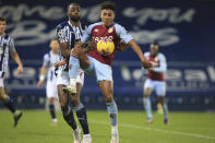 West Bromwich Albion's Semi Ajayi and Aston Villa's Ollie Watkins, center right, fight for the ball during the English Premier League soccer match between West Bromwich Albion and Aston Villa at the Hawthorns, West Bromwich, England, Sunday, Dec. 20, 2020. (Lindsey Parnaby/Pool via AP)