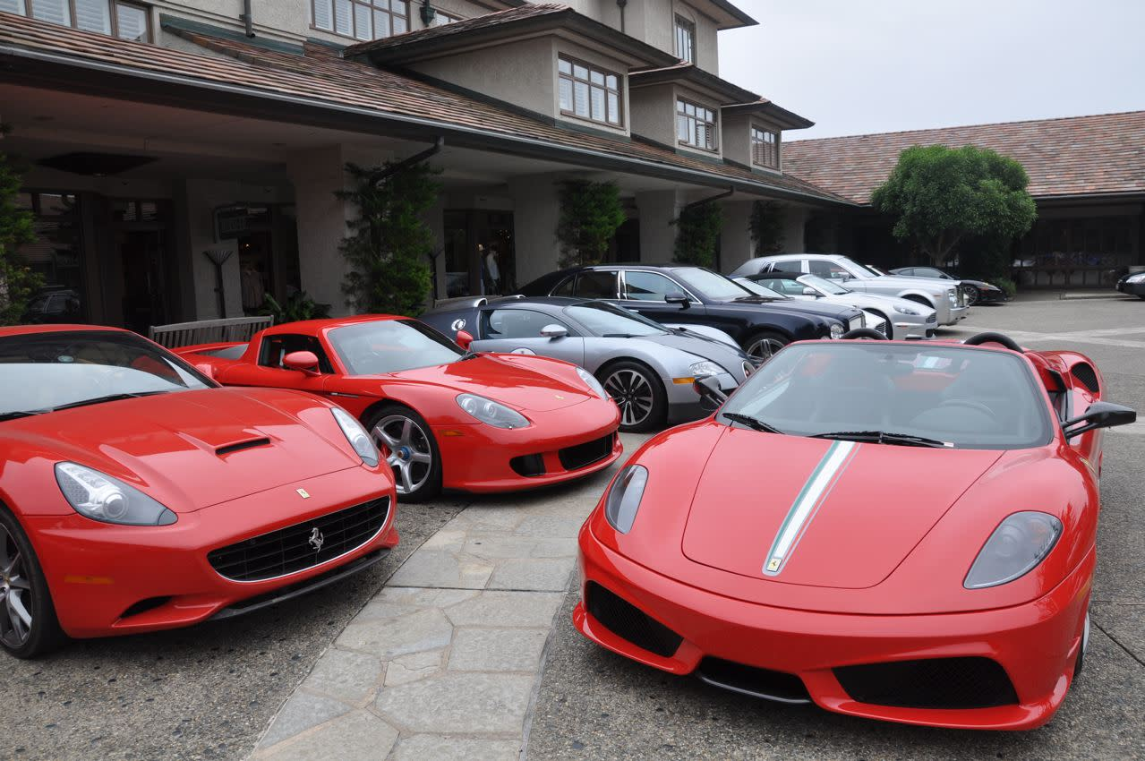 """Just your typical parking lot. The Inn at Spanish Bay wasn't even in the thick of the action, and the valet area still looks like this. """"What do we do with the 16M? There's no room."""" """"Just park it in front of that Carrera GT and the Veyron."""""""