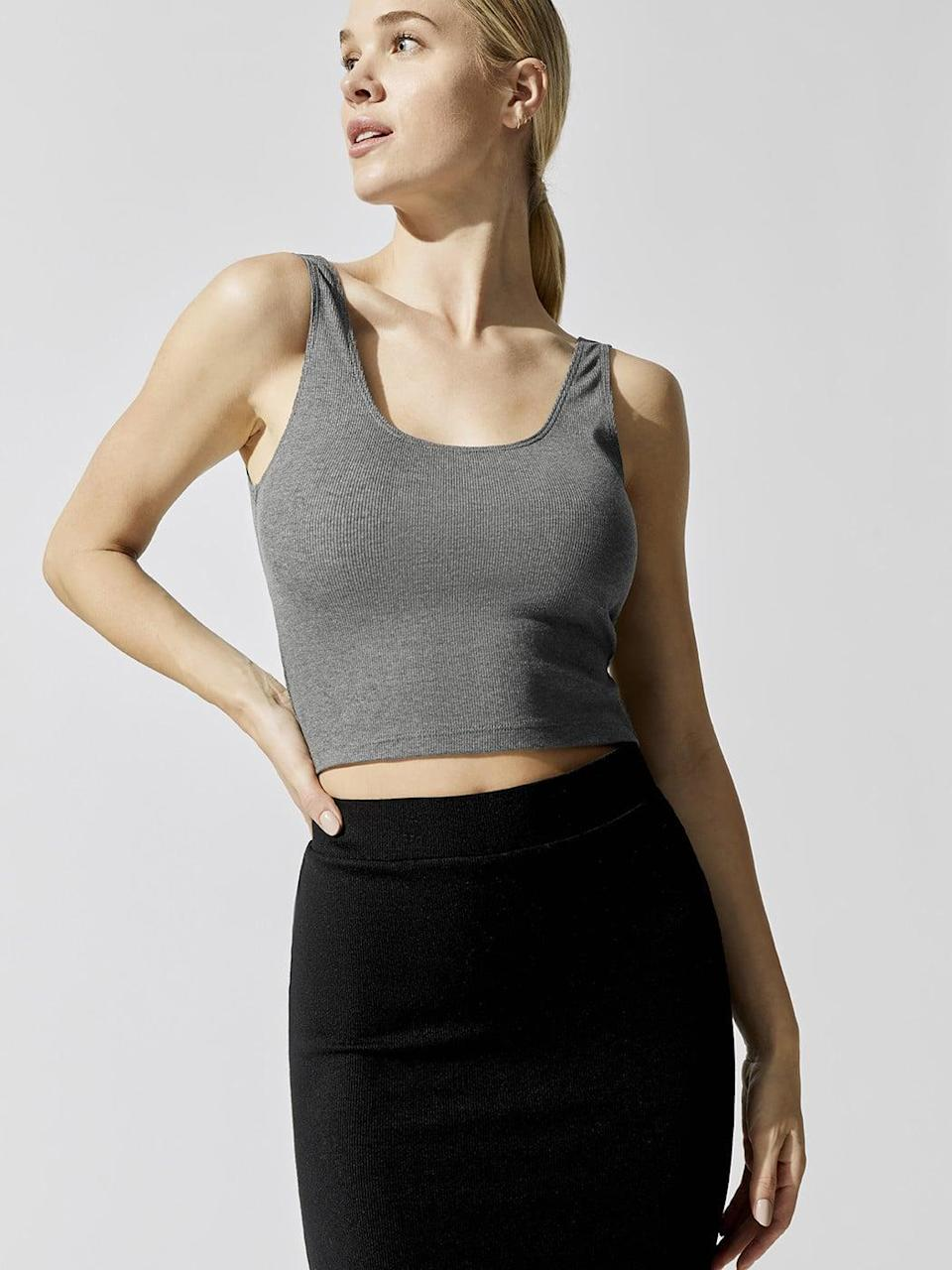 "<p>This cropped <a href=""https://www.popsugar.com/buy/Carbon-38-Scoop-Back-Ribbed-Tank-Top-578940?p_name=Carbon%2038%20Scoop%20Back%20Ribbed%20Tank%20Top&retailer=carbon38.com&pid=578940&price=48&evar1=fit%3Aus&evar9=47585636&evar98=https%3A%2F%2Fwww.popsugar.com%2Ffitness%2Fphoto-gallery%2F47585636%2Fimage%2F47585648%2FCarbon-38-Scoop-Back-Ribbed-Tank-Top&list1=shopping%2Cworkout%20clothes%2Csale%2Csale%20shopping&prop13=api&pdata=1"" class=""link rapid-noclick-resp"" rel=""nofollow noopener"" target=""_blank"" data-ylk=""slk:Carbon 38 Scoop Back Ribbed Tank Top"">Carbon 38 Scoop Back Ribbed Tank Top</a> ($48, originally $68) is a workout wardrobe basic.</p>"
