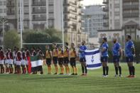 UAE and Israel rugby players listen to Israel national anthem before a friendly match in Dubai, United Arab Emirates, Friday, March 19, 2021. (AP Photo/Kamran Jebreili)