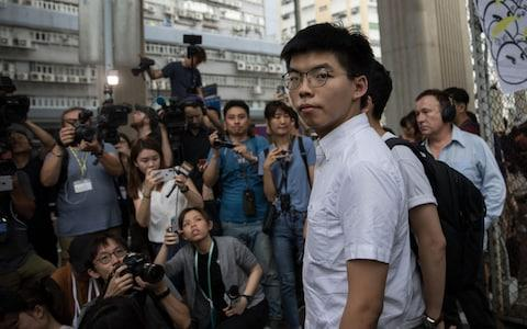 Joshua Wong thanks the media after being released - Credit: Rex
