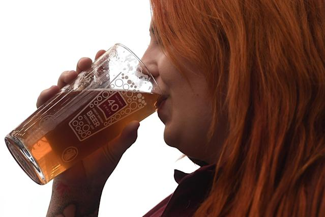 <p>A woman enjoys a pint of ale at the CAMRA (Campaign for Real Ale) Great British Beer festival at Olympia exhibition center on August 8, 2017 in London, England. (Photo: Carl Court/Getty Images) </p>
