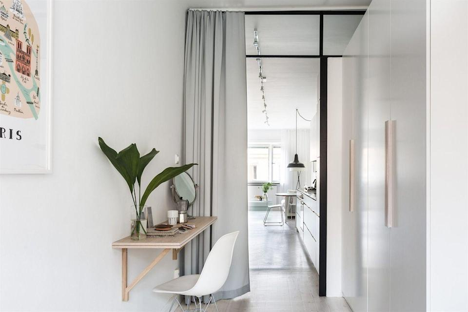 <p>Fancy, it's not, but a floating shelf can provide you with a dedicated place to crank out work when you're short on space. Just be sure that it's deep enough to fit your laptop and installed at the proper height. Then slide over a chair and get emailing. </p>